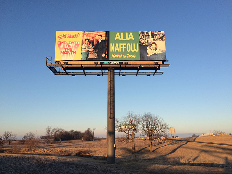 "Ken Lum's ""Bindy Sangeet, Employee of the Month"" and ""Alia Naffouj, Hooked on Tennis,"" installed on Main Billboard as seen from an angle"
